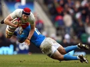 England's Nick Kennedy, left, is tackled by Italy's Gonzalo Garcia during their Six Nations rugby union international match at the Twickenham Stadium, London, Saturday Feb. 7, 2009. (AP Photo/Tom Hevezi)